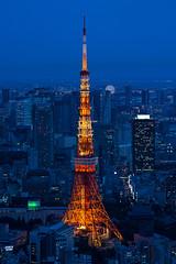 Tokyo Tower illuminated at dusk (basair) Tags: blue tower japan skyline night skyscraper tokyo iron downtown dusk eiffel tokyotower telecommunications