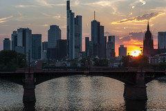 Sunny day in Frankfurt (frescographic) Tags: city sunset sun skyline clouds skyscraper dawn lights sonnenuntergang sundown frankfurt wolken citylights dmmerung mainhatten commerzbank maintower nikon1