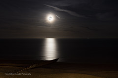An Easter Moon Over The Eastbourne Shore Line (clive_metcalfe) Tags: eastbourne moon lunar ocean sky night dark serene sea shingle pebbles groyne reflection moonlight horizon calm light
