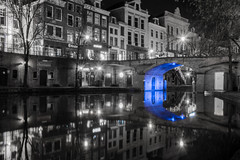 Blue light Bridge (kjeldvdh) Tags: old city bridge blue light urban bw house holland reflection brick history water netherlands lamp stone architecture bar night contrast buildings outside lights restaurant boat store nikon utrecht arch bright outdoor details bricks nederland overpass calm medieval route infrastructure shops build stores lumen trajectum