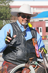 Cowboy Wave (wyojones) Tags: horse man smile hat sunglasses beard glasses cowboy texas houston wave rope shades parade bandana cowboyhat saddle trailride houstonlivestockshowandrodeo saddlehorn vesr wyojones houstonlivestockandrodeoparade