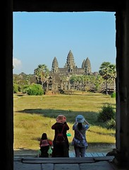 photographers at Angkor Wat (SM Tham) Tags: trees sky monument grass stone architecture palms temple cambodia khmer buddhist photographers angkorwat tourists unescoworldheritagesite doorway frame angkor grounds gatehouse flagstones gopura suryavarmanii