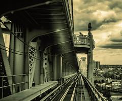 Motorcycle Cop on a Bridge (veyoung52) Tags: bridge bw train subway tracks motorcycle benfranklinbridge suspensionbridge camdem patco policeman delawareriver noiretbland
