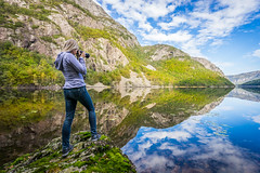 Reflecting (Richard Larssen) Tags: mountain lake lund reflection nature girl norway clouds landscape mirror norge day sony norwegen richard scandinavia rogaland mirrorreflection a7ii sonyalpha larssen teamsony richardlarssen drangsdalen sel1635z ranveigmarienesse