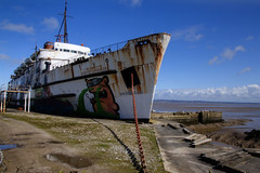 High and Dry (Tony Shertila) Tags: cruise abandoned weather wales boat rust rocks europe day ship britain outdoor horizon transport line trans wreck stranded mostyn dukeoflancaster partly cloudy 20160405121600