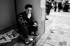 smoke break (Russell Siu) Tags: street bw hk white man black hongkong eyecontact cigarette candid smoke stare ssp shumshuipo