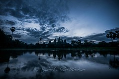 Silhouette of Angkor Wat (Syahrel Azha Hashim) Tags: morning travel light vacation holiday detail reflection building heritage history colors silhouette architecture clouds sunrise buildings temple lowlight nikon ruins colorful asia cambodia dof getaway details naturallight landmark angkorwat unesco tokina handheld bluehour shallow siemreap angkor simple dramaticsky 11mm touristattraction uwa historicbuildings 2015 ultrawideangle ancientarchitecture d300s syahrel goasean