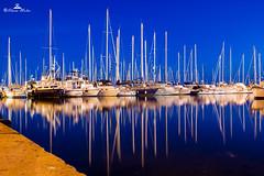 reflections (89lilly) Tags: sardegna city blue sunset sea sky italy reflection canon reflections boat reflex italia sardinia colours blu barche porto cielo riflessi cagliari sera citt riflesso porticciolo susiccu canon550d