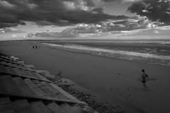 An evening on Crosby Beach (tabulator_1) Tags: blackwhite runner darkclouds crosby crosbybeach