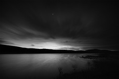 Carron Valley Reservoir at Night (Another Aspect) Tags: longexposure light sky blackandwhite lake nature monochrome night clouds landscape scotland outdoor stirling relaxing wideangle reservoir hills loch lowkey falkirk carronvalley landscapephotography centralscotland