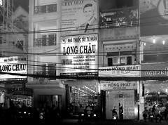 . (Out to Lunch) Tags: street urban monochrome architecture night bill blackwhite boards asia downtown fuji shot south east vietnam ba hai trung saigon mega polis 235 urbanite earthasia x100t