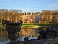 Winter walk in the park of Versailles castle (Sokleine) Tags: park sculpture france reflection castle pond versailles neptune fontaine iledefrance chteau parc reflets bassin yvelines chateaudeversailles frenchheritage