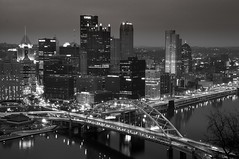 Downtown Pittsburgh at Night (Oliver Leveritt) Tags: longexposure nightphotography bridge blackandwhite water monochrome skyline architecture night silver buildings river pittsburgh cityscape waterfront dusk pennsylvania citylights lightroom mountwashington monongahelariver duquesneincline downtownpittsburgh cclr nikond90 afsdxvrnikkor18200mmf3556gifed oliverleverittphotography cclightroom