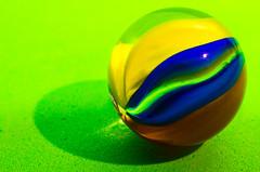 Cat's Eye on Green (L E Dye) Tags: canada macro 50mm nikon alberta macromonday d5100 extentiontube36mm ledye themevibrantandminimal