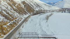 A Private Bridge Over a Frozen River (Part 4) (Dan Beland) Tags: road bridge trees winter usa snow art texture nature unmodified unitedstates artistic snowy freezing idaho willow northamerica rockymountains salmonriver snowcovered freshsnow unedited yellowline frozenriver wintry drone icejam highway93 nofilters noadjustments dji icecovered straightoffthecamera salmonidaho quadcopter privatebridge passingallowed northforkidaho phantom3professional