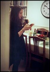 Kodak Retina (Type 143) - Lisa (TempusVolat) Tags: christmas camera woman clock film mobile 35mm vintage table phone kodak scanner lisa scan scanned wife wristwatch brunette scanning bookcase gareth charis retina tempus 143 girlonphone volat wonfor mrmorodo garethwonfor tempusvolat