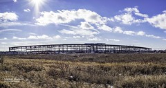 Transit Roundhouse Structure Panorama (G. Maxwell) Tags: ontario field clouds landscape outdoors weeds structures places olympus whitby sunburst constructionsite zuiko em1 2016 buildingsandlines olym714mmf28wideangle