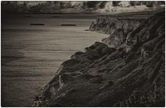 D-Day remnants (Eric@focus) Tags: sea sky clouds rocks dramatic cliffs landing worldwarii normandy dday invasion relics remnants mulberryharbour caissons goldbeach blackwhitephotos twtme nikond80 bwartaward scenicsnotjustlandscapes distinguishedblackandwhite landscapepro