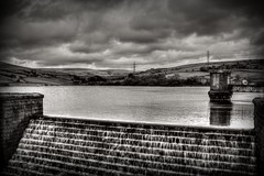 Reservoir Overflow (Missy Jussy) Tags: england sky bw water monochrome clouds landscape outside mono blackwhite village view northwest unitedkingdom outdoor reservoir lancashire hills fields walls pylons ogden pumphouse rochdale