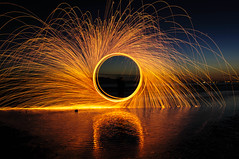 Firewheel (Michael Crossland) Tags: sunset fire sparks refelection