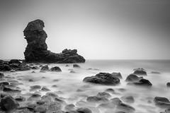 Conspicuous (Derek Coull) Tags: sea seascape scotland blackwhite rocks aberdeenshire boulders le northsea rockybeach seastack daytimelongexposure silkywater smoothsea hitechprostop10irnd oldmanofmuchalls manfrottopiximinitripod samsungnx500
