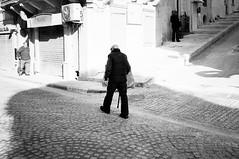 Prestige (gato-gato-gato) Tags: street leica bw sun white black classic film blanco monochrome analog person holidays europa europe flickr noir mt strasse urlaub negro streetphotography eu pedestrian rangefinder malta insel human streetphoto manual monochrom sonne weiss blanc ferien m6 manualfocus schwarz februar wetzlar onthestreets gozo passant mensch leicam6 mediterranian streetphotographer mittelmeer sden fussgnger manualmode strase filmisnotdead streetpic messsucher manuellerfokus gatogatogato fusgnger leicasummiluxm35mmf14 irrabatgawdex gatogatogatoch wwwgatogatogatoch streettogs believeinfilm