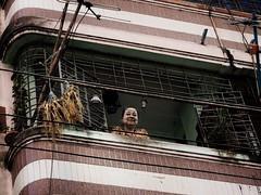 Smiling Ghost (Feldore) Tags: old woman eye smile smiling architecture downtown yangon burma ghost colonial olympus myanmar contact ghostly burmese mchugh thanaka em1 1240mm feldore