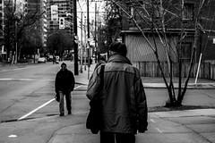 Going (Aaron Allen Rogers Toronto) Tags: street city urban blackandwhite toronto man cold walking person cloudy coat going rainy individual broadview