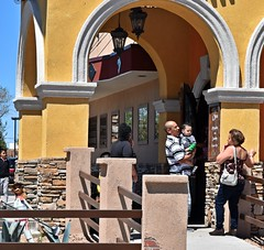 Restaurant Portals (Jo-We Got Rain-Yippee!!!) Tags: people baby man building lady fence restaurant large sunny mexican archway portals albuquerquenm theflickrlounge