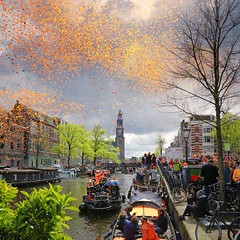 The sky colored orange on our King's Day (Bn) Tags: street party feest people music orange holiday holland water netherlands beer colors dutch amsterdam festival heineken boat kiss kissing king singing dancing market smoke free floating bikes kingdom swing canals celebration national trendy muziek carnaval prinsengracht alexander topf100 mokum topf200 gezellig amstel maxima willem jordaan oranje crowded westertoren straat westerkerk wester feestdag grachtengordel panden 100faves 200faves 27april koningsdag kingsday dansmuziek