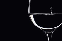 minimal (*Chris van Dolleweerd*) Tags: black macro water glass closeup dark studio 50mm wine drop wineglass lowkey liquid strobist chrisvandolleweerd