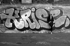 Graffiti with a beautiful girl (PIXXELGAMES - Robert Krenker) Tags: vienna wien street bridge urban blackandwhite white black girl beautiful beauty face sunglasses fashion grey graffiti cool artwork shoes slim candid makeup lifestyle protrait fujifilm suburb blacknwhite ritratto fujinon danube bnw biancoenero longhairs stylish darkglasses donaukanal streetstyle xt1 nocolours