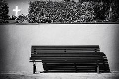 (ago.photo) Tags: blackandwhite monochrome cemetery bench lightsandshadows spain nikon missing cross outdoor empty grain monochromatic silence blacknwhite emptiness blackandwhitephotography nikond5200