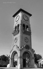Does Anybody Really Know What Time It Is (Day Night Tripper) Tags: california city bridge trees windows urban blackandwhite bw white house black streets tower cars clock face architecture buildings river landscape outdoors lights hotel town office iron theater 5 bricks wroughtiron motel arches canals clocktower kern freeway ag oil roads agriculture bakersfield levee wrought weirs kernriver kerncounty kernisland dogwood52challenge