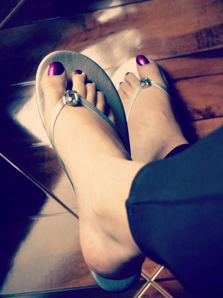 image Tart wearing very high black stilettos live on uk morning tv