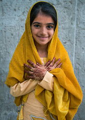 little girl with henna on the hands for a traditional wedding, Qeshm Island, Salakh, Iran (Eric Lafforgue) Tags: wedding portrait people girl beautiful childhood vertical scarf outdoors kid clothing asia child dress iran muslim islam young ceremony culture traditions marriage persia grace henna custom graceful cultures cultural oneperson islamic middleeastern frontview persiangulf elegance sunni qeshmisland hormozgan lookingatcamera  bandari  1people  iro onegirlonly onlychildren straitofhormuz  colourpicture  salakh irandsc03624