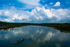 When the clouds meets the land and water (Vj Clickzz) Tags: lighting trip blue sky india mountains green nature water colors beautiful sunshine clouds reflections landscape outdoors boat seaside nikon scenery exposure alone skies natural emotion earth expression framed unique indian awesome ngc transport goa streetphotography naturallight landmark scene vj hills traveller explore urbannature mornings raft bliss quick picturesque refreshing magical effect backwaters allalone waterways waterscape beachside naturephotography quickshot naturallighting travelphotography onwater landscapephotography scenicbeauty godscreation naturesgift nikond5200 vjclickz