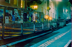 Alley Way + Bus Lights - Bergen at Night (jasonkb) Tags: nightphotography norway night 50mm iso800 norge takumar 35mmfilm nightscene bergen smc c41 homedeveloped filmisnotdead homedevelopment prakticaiv prakitca cinestill c41development filmneverdies believeinfilm buyfilmnotmegapixels praktica4