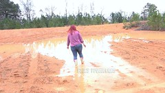 Scarlet Playing in Huge Mud Puddles in Rain Boots (Fanta_Productions) Tags: boots curvy muddy rainboots muddyboots mudpuddles wetandmessy videoscreenshot playinginmud bootsoverjeans