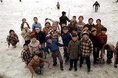 31-599 (ndpa / s. lundeen, archivist) Tags: city winter people snow color fall film ice boys smile hat smiling kids 35mm children sweater clothing coat nick group citylife hats korea clothes korean gloves seoul 1970s coats hillside iceskates southkorea sled 1972 31 skates sleds dewolf nickdewolf photographbynickdewolf reel31