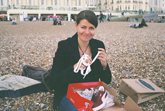 shoe shopping in Brighton 2 (Siv Nilsen) Tags: woman film beach analog 35mm shopping lomo shoes pebbles analogue puma 8m smena pleased