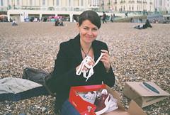 shoe shopping in Brighton 2 (Siv Nilsen) Tags: woman film beach analog 35mm shopping lomo shoes pebbles analogue puma 8m smena pleased