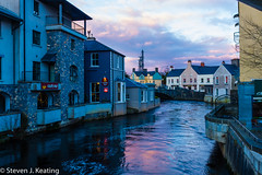 Evening in Ennis (stevenkeating58) Tags: street city bridge blue ireland wet water river landscape evening spring cafe shops ennis waterways countyclare