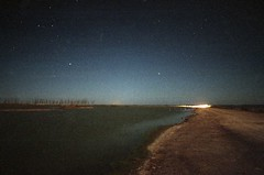 (. Lautaro Garcia .) Tags: nightphotography trees sky lake tree green film water argentina night noche nightshot pentax space paisaje astrophotography agfa shores landcape c41 filmphotography provinciadebuenosaires
