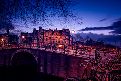 (angheloflores) Tags: longexposure travel houses sunset sky urban holland netherlands colors amsterdam architecture clouds reflections canal cityscape bikes explore gracht brouwersgracht