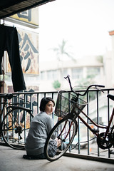 (I C E I N N) Tags: trees portrait people girl sign socks metal fence buildings asian concrete 50mm grey blurry uniform moody dof photoshoot floor bokeh outdoor sony flash gray chinese bikes skirt bicycles e trousers mandarin handrail fe   schoolgirl speedmaster gaze cardigan creamy pleated f095 nissin lookback  zhongyi kneehigh air1 mitakon  sonya7ii ilce7m2 di700a