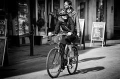 Pedal Power (Steve Greene Photography) Tags: street urban blackandwhite woman bike town candid streetphotography shops stroud nikond40