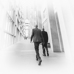 Official Business (Lazy_Artist) Tags: light white black men art walking official gallery shadows ottawa national fade