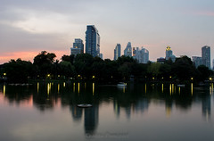 Evening Time (pummipat_sukpol) Tags: park sky water canon buildings landscape thailand evening twilight outdoor bangkok thai kit 1855 silom lumpini lumphinipark