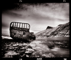 Wrecked (tsiklonaut) Tags: bw white black 120 film blanco water monochrome analog landscape ir island mono bay iceland ship y pentax drum scanner negro dream dramatic vessel cargo scan dreaming infrared roll beached medium format dreamy fjord analogue 6x7 wreck carrier aura 67 analogica mv contrasty mustvalge westfjords efke drumscan analoog pmt infrapuna maastik ir820 photomultipliertube keskformaat
